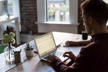 Man Checking Growth Oriented Portfolio Returns on Computer