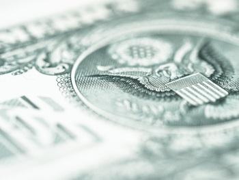 US Seal on Dollar Bill Representing Money Earned from Bond Portfolio