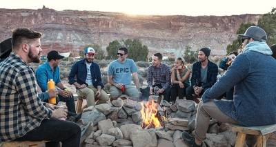 People Wealth Advisors Can Help Sitting Around a Fire